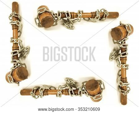 A Frame Made Of Wooden Gavels Wrapped With Steel Chains To Represent Legal Binding Policy Stationery