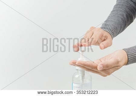 Female Hands Using Washing Hand With Alcohol Sanitizer Isolate On A White Background. Promoting Peop