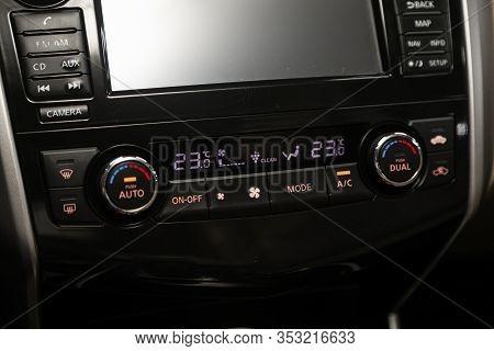 Novosibirsk, Russia - December 29, 2019:  Nissan Teana,  Modern Black Car Interior: Climat Control V