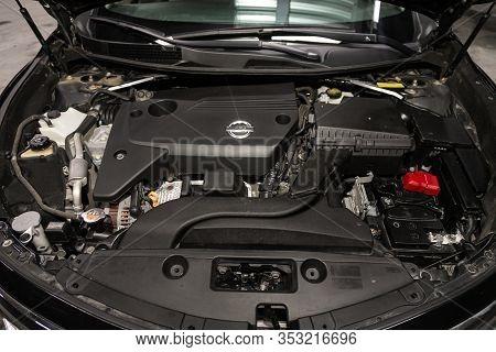 Novosibirsk, Russia - December 29, 2019:  Nissan Teana,  Close Up Detail Of  Car Engine, Front View.