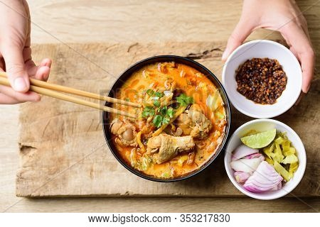 Traditional Northern Thai Food (khao Soi), Spicy Curry Noodles Soup With Coconut Milk And Chicken Ea