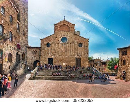 San Gimignano, Italy - June 21: View Of The Collegiate Church Of Santa Maria Assunta, Iconic Basilic