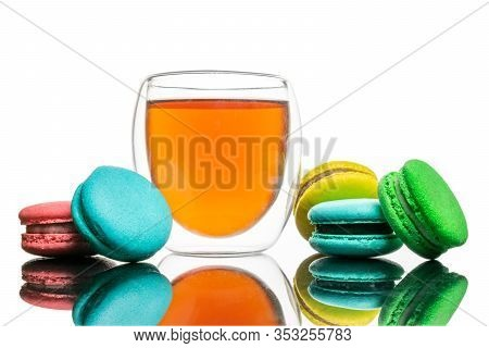 Glass Cup Black Tea, Macaroons Cookies Isolated On White. Colorful And Sweet French Macaroons Backgr