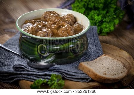 Pork Meatballs With Noodles In A Green Bowl. Selective Focus.