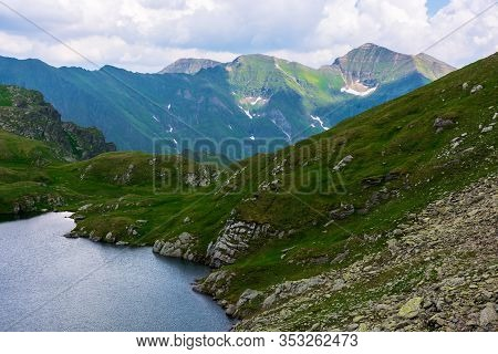 Goat Lake In The Fagaras Mountains Of Romania. Popular Travel Destination. Summer Nature Scenery Wit