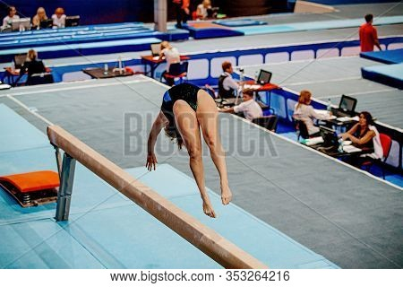 Female Gymnast Athlete Balance Beam Flip In Gymnastics