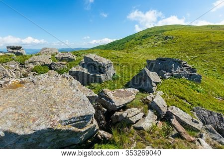Rocks On The Alpine Hillside Meadow. Beautiful Summer Nature Scenery. Green Grass On The Hills And F