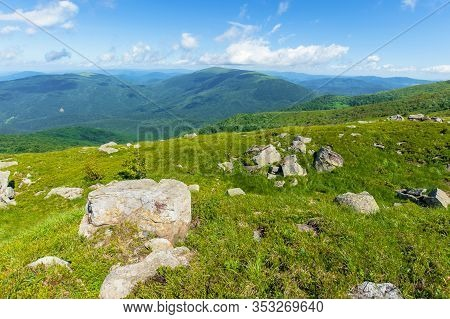 Rocks On The Alpine Meadow. Beautiful Summer Scenery Of Runa Mountain. Rural Valley In The Distance.