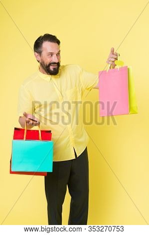 Shop And Enjoy. Shopping Addict Yellow Background. Mature Man Hold Shopping Bags. Happy Shopper With