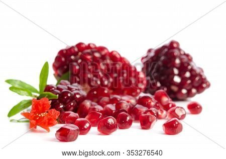 Parts Of A Pomegranate With Pomegranate Seeds And Leaves, Flowers Isolated On White Background