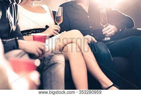 Friends Talking At A Party. Stylish Trendy People Drinking Champagne And Having A Conversation. Coup