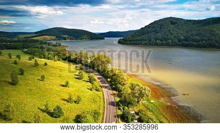 Summer Landscape With Lake And Mountains. Road On The Lakeside