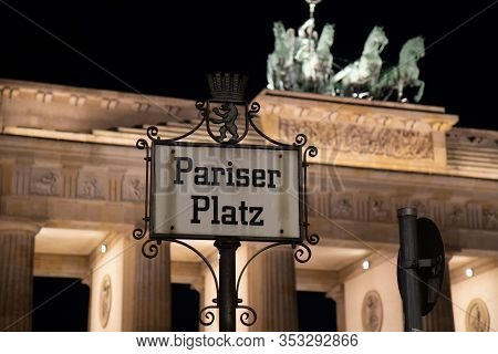 An Old Style Signpost With The German Name Pariser Platz (paris Square) Which Is Placed In Front Of