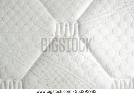 Mold On A Mattress. Black Stains On A White Fabric.