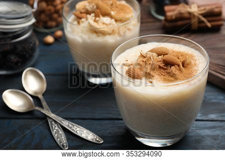 Delicious Rice Pudding With Almonds And Cinnamon On Dark Wooden Table
