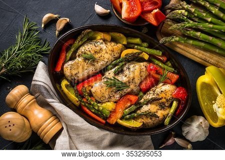 Baked Chicken Fillet With Vegetables. Healthy Food, Keto Diet, One Pot Dish. Top View At Dark Table.
