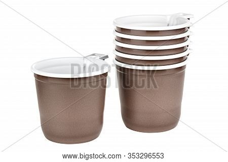 Standing One Alone And Five In Set Unused Disposable White Plastic Mugs With Brown Satin Texture On