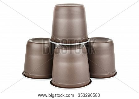 Pyramid Of Four Upside Down Unused Disposable White Plastic Mugs With Brown Satin Texture On The Out