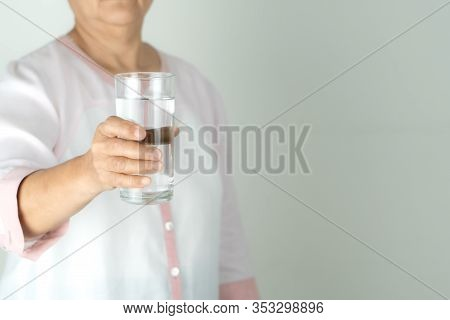 Drinking Water In The Senior Woman's Hand, Concept Of Environment Protection, Healthy Drink.