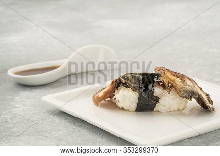 Unagi Nigiri Sushi With Eel Fish On White Plate.