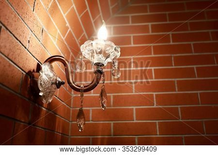 Lamp On Brick Wall