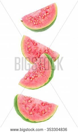 Isolated Guava Slices. Four Wedges Of Green Pink Fleshed Guava Fruits Isolated On White Background W