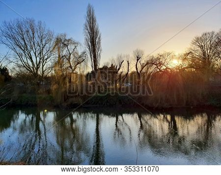 Tranquil Waterside Sunset With Natural Water Reflections In East London Canal