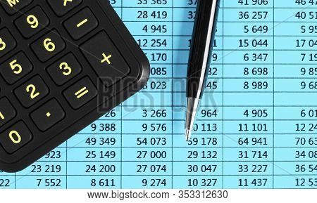 Financial Concept. Calculator, Pen And Glasses On Financial Documents. Financial Accounting. Balance