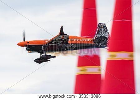 Zamardi / Hungary - July 13, 2019: Nicolas Ivanoff With N4767 Zivko Edge 540 Flying Over Lake Balato