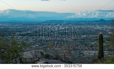 View Of Phoenix, Arizona At Twilight From A Mountain