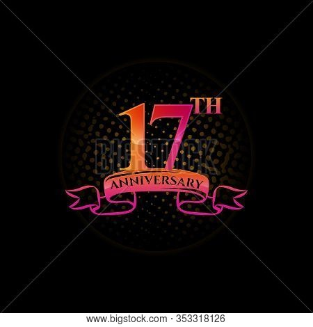 Celebrating The 17th Anniversary Logo, With Gold Rings And Gradation Ribbons Isolated On A Black Bac