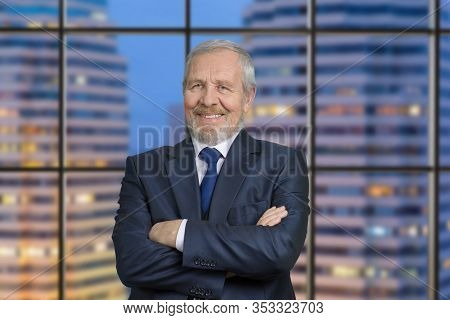 Old Tv Presenter Portrait. Anchorman With Folded Arms. Business Man In Suit Against Windows Backgrou