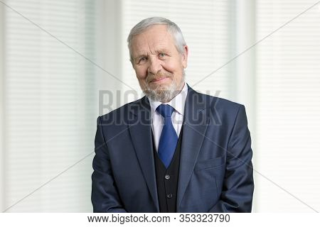 Smiling Old Man In Suit Portrait. Senior Office Manager. Windows With Jalousie Background.