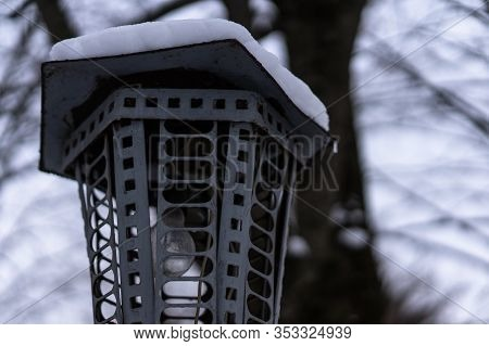 Lamppost With Snow On The Cover.lamppost With Snow On The Cover