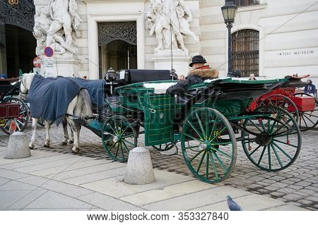 Vienna, Austria - February 19, 2020: Famous Vienna Horse Carriages Waiting In Front Of The Hofburg F