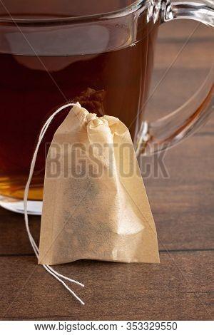 Self Filled Tea Bag Wtih A Cup Of Herbal Tea