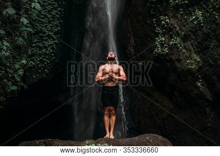 A Man Of Athletic Build Does Yoga. Healthy Lifestyle. The Concentration Of The Body. A Man Does Yoga