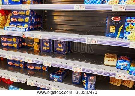 Paris, France - February 29, 2020: Half Empty Shelves At Parisian Supermarket During Outbreak Of Cor