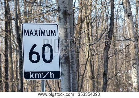 A Speed Limit Road Sign In Ontario, Canada Has A Posted Maximum Of 60 Km/h, Or Sixty Kilometers Per