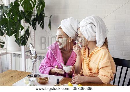 Mum And Daughter Put Facial Mask On Face