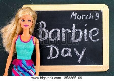 Tambov, Russian Federation - February 24, 2020 Blond Barbie Doll And Blackboard With Words Barbie Da