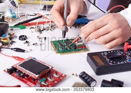 Faceless Technician Repairing Smartphone's Motherboard In Lab, Radioman Soldering Spare Part Of Comp