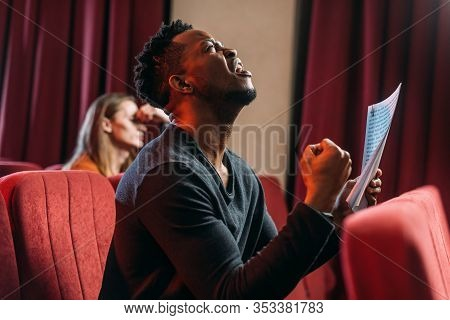 African American Sad Actor Shouting And Rehearsing In Theatre With Young Actor