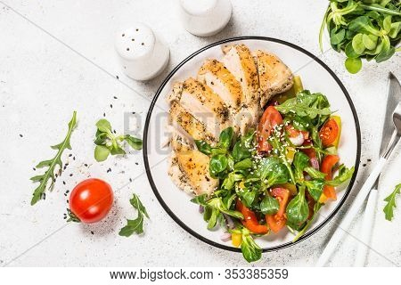 Baked Chicken Breast With Green Salad From Vegetables On White Plate. Healthy Food, Keto Diet. Top V