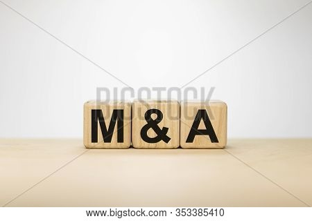 Merger And Acquisition Industry Corporation Partnership Concept. Word Ma On Wooden Cubes On White Ba