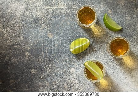 Gold Tequila. Mexican Gold Tequila Shot With Lime And Salt On A Stone Light Concrete Worktop. Top Vi