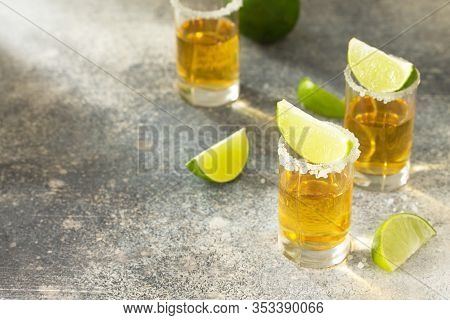Gold Tequila. Mexican Gold Tequila Shot With Lime And Salt On A Stone Light Concrete Worktop. Copy S