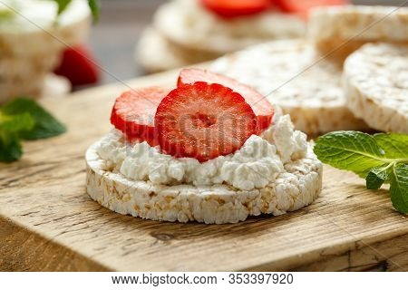 Rice Crackers With Ricotta And Strawberries On Wooden Board. Healthy Food