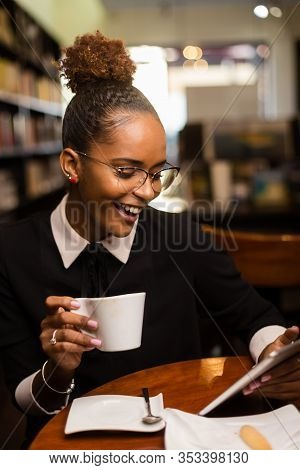 Black African American Young Yoman Drinking Coffee