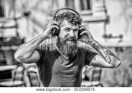 Music Beat For Energetic Mood. Rhythm For Walk. Man Bearded Hipster Headphones Listening Music. Hips